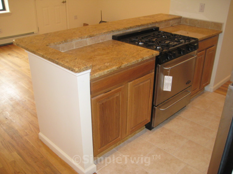 A full stove/oven and peninsula make this apartment desirable to tenants. Plenty of storage and countertop space.